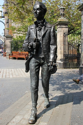 Bronze figure by David Annand of Robert Fergusson outside Edinburgh's Canongate Kirk where the poet is buried.