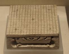 A 19x19 Go board model from a Sui dynasty (581–618 CE) tomb.