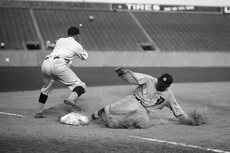 Ty Cobb, second all-time in career triples, slides safely into third base.