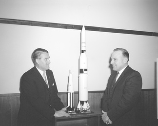 Marshall Space Flight Center Director Wernher von Braun and Representative Waggonner discuss Apollo models.