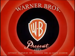 "The ""Warner Bros. Presents"" title card from the first wave of color cartoons in the ""Looney Tunes"" series of cartoon shorts, from October 1942 until May 1947."