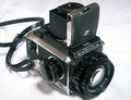 Medium format SLR by Bronica (Model S2), Japan. Bronica's later model—the Bronica EC—was the first medium format SLR camera to use an electrically operated focal-plane shutter