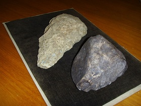"Stone tool (Oldowan style) from Dmanisi paleontological site (right, 1.8 mya, replica), to be compared with the more ""modern"" Acheulean style (left)"