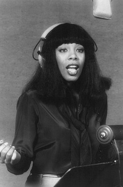 Donna Summer wearing headphones during a recording session in 1977