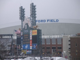Ford Field on Super Bowl XL Sunday, countdown to kickoff on Comerica Park's score board.