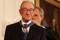 President George W. Bush presents the Presidential Medal of Freedom to Alan Greenspan, on November 9, 2005, in the East Room of the White House.