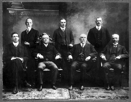 Inaugural Departmental Heads of the Australian Commonwealth Public Service-1901Standing (l-to-r): Muirhead Collins (Defence);[13] Atlee Hunt (External Affairs);[14] David Miller (Home Affairs).[15] Seated (l-to-r): Robert Garran (Attorney-General's);[16] Harry Wollaston (Trade and Customs);[17] Robert Scott (Post-Master General's);[18] George Allen (Treasury).[19]
