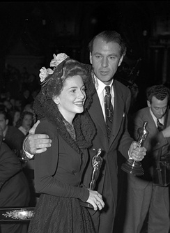 Photo of Joan Fontaine and Gary Cooper at the Academy Awards holding their Oscars