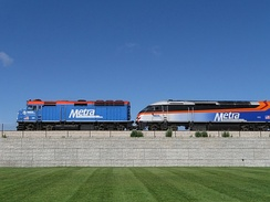 The EMD F40PH (left) and MPI MPXpress-series MP36PH-3S (right) locomotives coupled together by Metra use diesel–electric transmission.