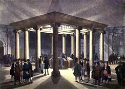 Interior of the London Coal Exchange, c. 1808.European 17th-century colonial expansion, international trade, and creation of financial markets produced a new legal and financial environment, one which supported and enabled 18th-century industrial growth.
