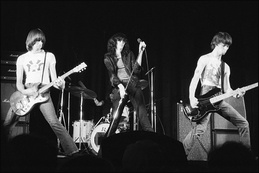 The Ramones (pictured in 1977), who were influenced by garage rock, spearheaded the mid-1970s punk movement in New York.