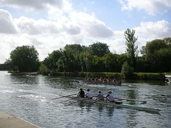 Rowing on the Isis opposite the Oxford college boathouses.