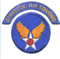 The 1946–1951 SAC patch (above) was replaced by the patch with insignia that won a SAC contest.