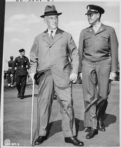 Stimson and Colonel William H. Kyle (right) arrive at the Gatow Airport in Berlin, Germany to attend the Potsdam Conference (July 16, 1945).