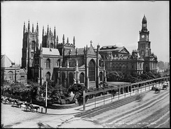 Sydney Town Hall, on George Street, as it appeared in the early 1900s with St Andrew's Cathedral to the left.
