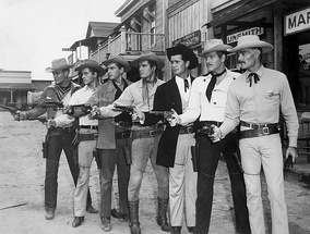 Publicity still with 1959 Warner Bros. Western series leads Will Hutchins (Sugarfoot), Peter Brown (Lawman), Jack Kelly (Maverick), Ty Hardin (Bronco), James Garner (Maverick), Wayde Preston (Colt .45), and John Russell (Lawman)
