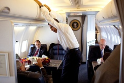 President Obama and staffers aboard a C-32A as Air Force One in 2009 showing the second and third section.