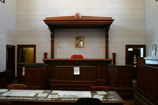 "A judge's bench in a courtroom in Beechworth, Victoria, Australia. The term ""bench"" is also used as a metonym to mean all the judges of a certain court or members of a judiciary."
