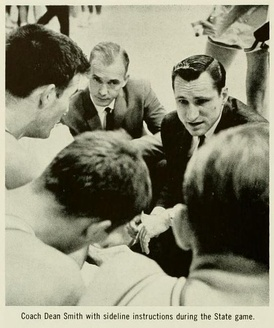 Dean Smith (right) during the 1964 UNC v. North Carolina State game.