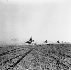 British tanks advance to engage German armour after infantry had opened gaps in the Axis minefield at El Alamein, 24 October 1942