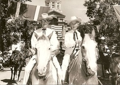 "Governor Gage with wife ""Buddy"" riding in the Frontier Days Parade in Cheyenne, WY, July 1962"