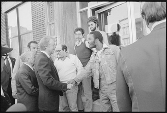 President Carter shakes hands with residents of  Bronx, NYC, shortly after being elected.