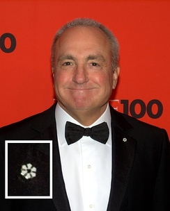 Lorne Michaels wearing a Member's lapel pin during a formal event