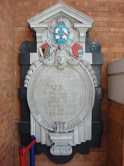 Memorial to East Anglians who died during the First World War in Liverpool Street Station. The memorial, erected by the London Society of East Anglians, displays the flag
