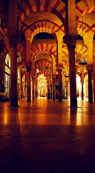 Interior of the Mosque–Cathedral of Córdoba formerly the Great Mosque of Córdoba. The original mosque (742), since much enlarged, was built on the site of the Visigothic Christian 'Saint Vincent basilica' (600).