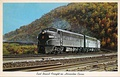 Postcard painting of Pennsy diesel freight train descending Horseshoe Curve