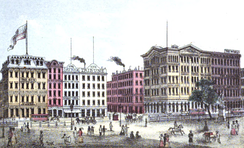 Printing House Square in Manhattan in 1868, showing the sign for The Revolution's office at the far right below The World and above Scientific American.