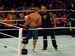 The Rock and John Cena (left) on Raw, agreeing to a match at WrestleMania XXVIII one year in advance