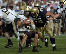 Cutler being sacked by Navy linebacker Jeremy Chase