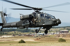 AH-64 during an extraction exercise at Camp Bondsteel, Kosovo in 2007 with a soldier on the avionics bay.