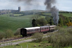 A steam train on the Downpatrick and County Down Railway travelling through the Ulster drumlin belt near Downpatrick.