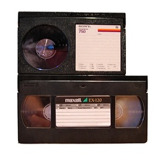 Size comparison between Betamax (top) and VHS (bottom) videocassettes.