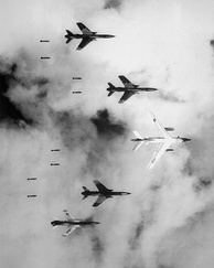 A U.S. B-66 Destroyer and four F-105 Thunderchiefs dropping bombs on North Vietnam during Operation Rolling Thunder