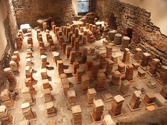 Caldarium from the Roman Baths at Bath, in Britain. The floor has been removed to reveal the empty spaces through which the hot air would flow.