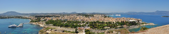 Panoramic view of the old Corfu City, a UNESCO World Heritage Site, as seen from the Old Fortress. The Bay of Garitsa is to the left and the port of Corfu is just visible on the top right. Spianada Square is in the foreground.