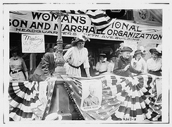 Daisy Harriman (in white) oversees a Democratic rally in Union Square, New York City