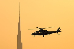 Dubai Police Agusta A-109K-2 in flight near Burj Khalifa