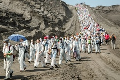 Environmental activists blocking a coal mine to promote fossil fuel phase-out
