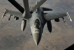 An F-16 Fighting Falcon being refueled after an airstrike on ISIL targets in Syria