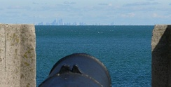 Historic cannon at Fort Niagara; Toronto across the lake