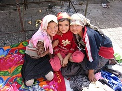 Three Uyghur girls at a Sunday market in the oasis city Khotan
