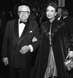 "Mayer with Joan Crawford at the premiere of Torch Song, 1953.""To me,"" she once stated, ""L.B. Mayer was my father, my father confessor, the best friend I ever had.""[62]"