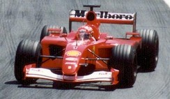 Michael Schumacher clinched his fourth World Championship with a victory at the Hungarian Grand Prix.
