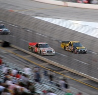 Mike Skinner racing Todd Bodine in the Craftsman Truck Series race at Texas.