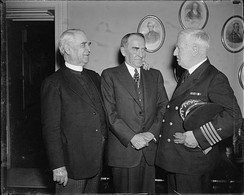 Washington, D.C., March 25, 1937: Navy Chaplain Edward Duff opens the House of Representatives with a prayer for the first time since 1820. It was the first time in 117 years that the Navy was again honored in giving the invocation. Left to right: James S. Montgomery, Chaplain of the House; Speaker William Bankhead; and Capt. Edward A. Duff, Chief of Chaplains U.S. Navy
