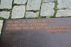 "Plaque at the Nazi book burning memorial on Bebelplatz in Berlin, Germany. The plaque has a quote from Heinrich Heine's play Almansor (play, written 1821–1822). ""Where they burn books, in the end they will also burn human beings"" (Dort, wo man Bücher verbrennt, verbrennt man am Ende auch Menschen) about burning of Quran in Granada that was expected to be followed by burning humans (Muslims then Jewish) in 1500s."